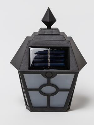 Farol solar con luz calida